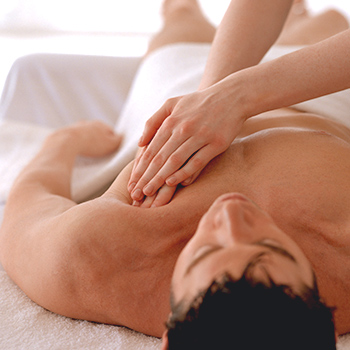 MetaTouch massage therapist treating client with personalized massage program.